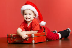 Little Cute Boy With Red Suitcase Stock Photo
