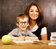 Little cute boy with young teacher in classroom Stock Photography