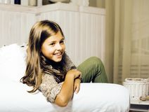 Little cute brunette girl at home interior happy smiling close u. P, lifestyle real people concept stock photography