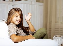 Little cute brunette girl at home interior happy smiling close u. P, lifestyle real people concept royalty free stock images