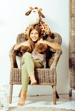 Little cute brunette girl at home interior happy smiling close u. P, lifestyle real people concept royalty free stock photo