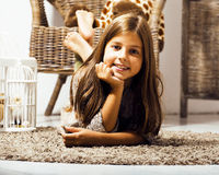 Little cute brunette girl at home interior happy smiling close u. P, lifestyle real people concept stock images