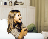 Little cute brunette girl at home interior happy smiling close u. P, lifestyle real people concept royalty free stock image