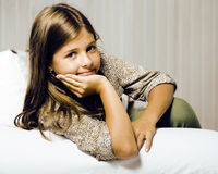 Little cute brunette girl at home interior happy smiling close u. P, lifestyle real people concept royalty free stock photos