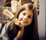 Little cute brunette girl at home interior happy smiling close u. P, lifestyle real people concept stock photos