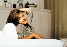Little cute brunette girl at home interior happy smiling close u Stock Images