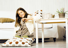 Little cute brunette girl at home interior happy smiling close u Stock Photos