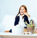 Little cute brunette girl at home interior happy smiling close up, lifestyle people concept Royalty Free Stock Image