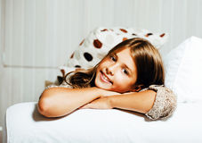 Little cute brunette girl at home interior happy smiling close up, lifestyle real people concept. Closeup stock images