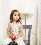 Little cute brunette girl at home interior happy smiling close up, lifestyle real people concept. Closeup stock photo