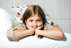 Little cute brunette girl at home smiling close up Stock Photos