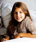 Little cute brunette girl at home smiling close up. 7 years old royalty free stock image