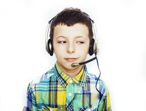 Little cute caucasian boy in headphones posing happy smiling isolated on white background, lifestyle people concept. Closeup stock image