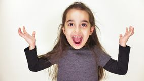 Little cute caucasian girl, smiling, showing an emotion of surprise, wide-open mouth, portrait white background 50 fps stock footage