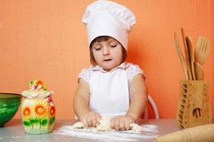 Little cute chef cooking biscuits Royalty Free Stock Photos
