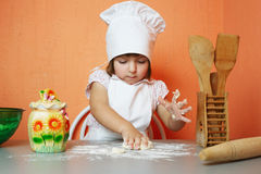 Little cute chef cooking biscuits. Photo of little cute chef cooking biscuits Royalty Free Stock Photo