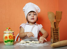 Little cute chef cooking biscuits. Photo of little cute chef cooking biscuits Royalty Free Stock Images