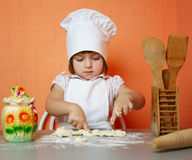 Little cute chef cooking biscuits. Photo of little cute chef cooking biscuits Royalty Free Stock Photography