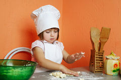 Little cute chef cooking biscuits. Photo of little cute chef cooking biscuits Stock Photography