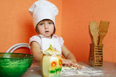 Little cute chef cooking biscuits. Photo of little cute chef cooking biscuits Stock Images