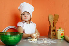 Little cute chef cooking biscuits. Photo of little cute chef cooking biscuits Royalty Free Stock Image