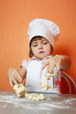 Little cute chef cooking biscuits. Photo of little cute chef cooking biscuits Stock Photos