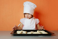 Little cute chef cooking biscuits. Photo of little cute chef cooking biscuits Royalty Free Stock Photos