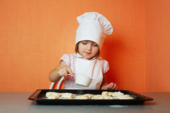 Little cute chef cooking biscuits. Photo of little cute chef cooking biscuits Stock Image