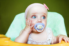 Little cute child with baby's dummy Royalty Free Stock Image
