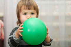 Little cute child blow a ball Royalty Free Stock Photo