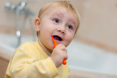 Little cute child brushing her teeth. The little cute child brushing her teeth stock photography