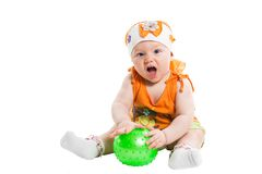 Little cute child girl with ball isolated on white background. Royalty Free Stock Photos