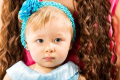 Little cute child girl with blue eyes . Royalty Free Stock Photo