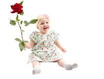 Little cute child girl with flower isolated on white background. Royalty Free Stock Photo