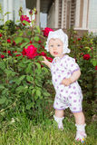 Little cute child girl with flower on nature. Royalty Free Stock Images