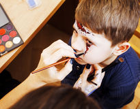 Little cute child making facepaint on birthday party, zombie Apo Royalty Free Stock Photo