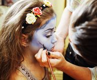 Little cute child making facepaint on birthday party, zombie Apo Stock Images