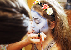 Little cute child making facepaint on birthday party, zombie Apo Stock Photo