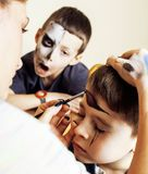 Little cute child making facepaint on birthday party, zombie Apo Stock Photography
