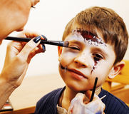 Little cute child making facepaint on birthday party, zombie Apo Royalty Free Stock Images