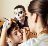 Little cute child making facepaint on birthday party, zombie Apocalypse facepainting, halloween preparing. Concept Royalty Free Stock Images