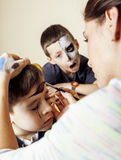 Little cute child making facepaint on birthday party, zombie Apocalypse facepainting, halloween preparing concept. At home Royalty Free Stock Photos