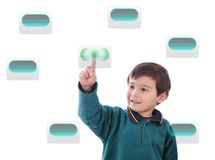 Little cute child pressing digital buttons Stock Photo