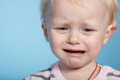 Little cute child with tears on face Stock Image