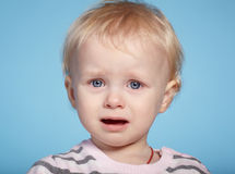 Little cute child with tears on face Stock Photos