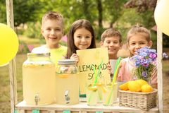 Little children at lemonade stand in park. Little cute children at lemonade stand in park royalty free stock photos