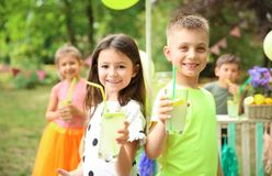 Little children with natural lemonade in park Royalty Free Stock Images
