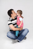 Little cute daughter kisses her father Stock Photography