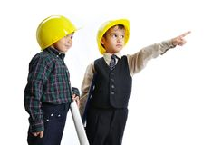 Little cute engineers isolated, kids playing toget Royalty Free Stock Images