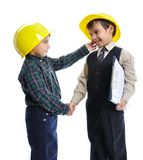 Little cute engineers isolated, kids playing together Stock Image
